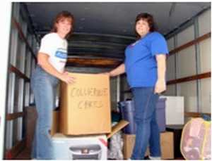 Volunteers loading truck with donations